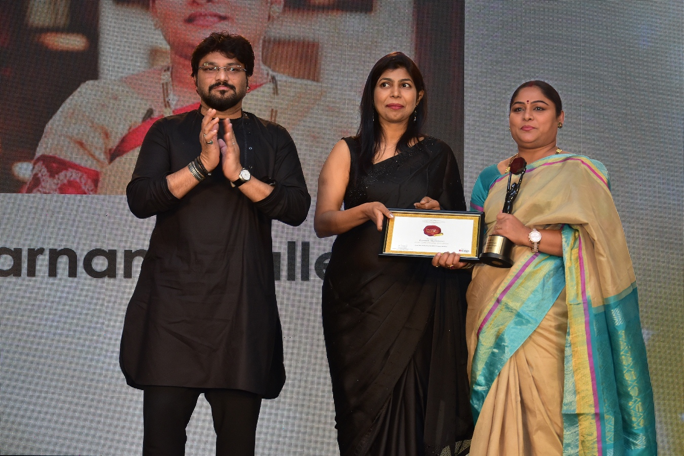 Karnam Malleshwari being awarded at The Economic Times Iconic Brands 2018